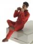 AT Collections 32128 - Sitzender Farmer in der Pause isst einen Sandwich vorne links