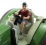 AT-Collections 32141 - Teenager Jaff fährt Traktor auf Siku Trecker