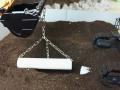 Siku Control 32 - Bagger Komatsu mit Rohr an Kette