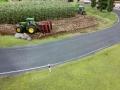 Farmworld Fehmarn - John Deere mit Heckgrubber