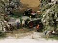 Deutz mit Holzspalter im Schnee