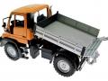 Welly 32380F-2GA - Mercedes Benz Unimog U400 Orange gekippt hinten links