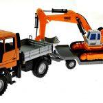Welly 32380F-2GA - Mercedes Benz Unimog U400 Orange mit Tieflader